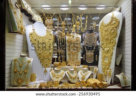 DUBAI, UNITED ARAB EMIRATES (UAE) - FEB 04, 2014: Luxury gold jewelry in vitrine jewelry store  - stock photo