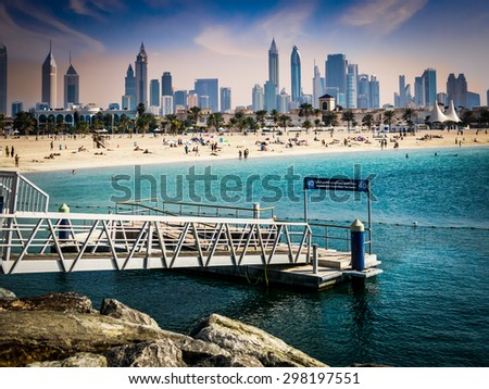 DUBAI, UNITED ARAB EMIRATES (UAE) - JANUARY 24, 2014: Waterfront skyline of the city of Dubai from Jumeirah Beach, United Arab Emirates - stock photo