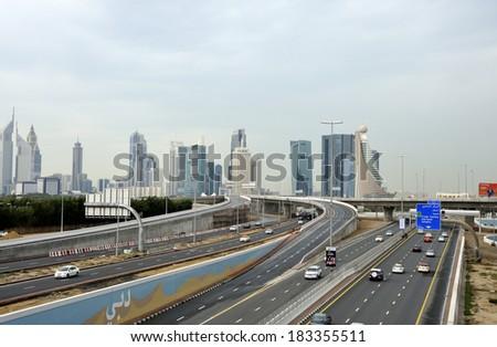 DUBAI UNITED EMIRATES - FEBRUARY 9, 2014: Traffic on highway Sheikh Zayed Road leading to the city center. February 9, 2014 Dubai, United Arab Emirates - stock photo