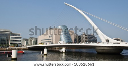 Dublin city skyline cityscape Ireland. The Samuel Beckett Bridge crosses the Liffey River in Dublin. The Convention Centre Dublin in the Dublin Docklands Ireland. Dublin city landmark.
