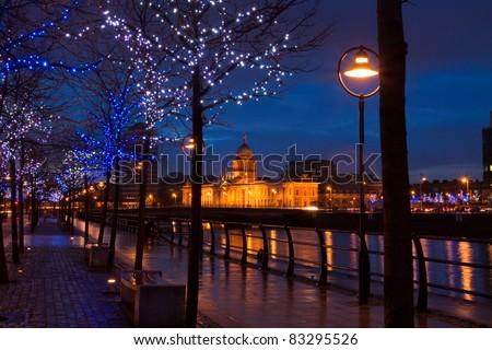 Dublin Custom House at dusk surrounded by lights - stock photo