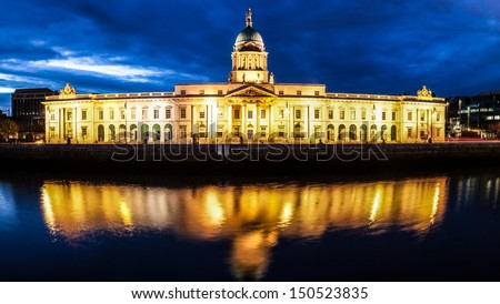Dublin Custom House at night with reflection in the river Liffey - stock photo