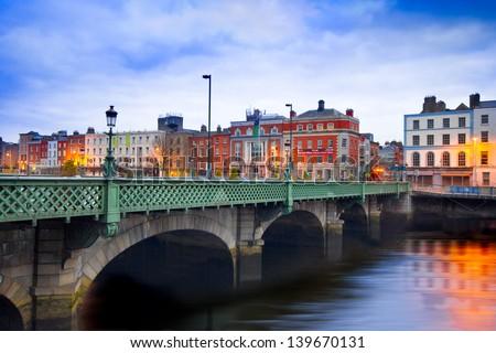 DUBLIN, IRELAND - APRIL 1:  Grattan Bridge in Dublin, Ireland on the evening of April 1, 2013. This historic bridge spans the River Liffey in Dublin, Ireland. - stock photo
