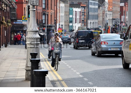 DUBLIN IRELAND - APRIL 17, 2011 : The traffic in Dublin city has many type of transportation. There are cars, buses even bicycles.