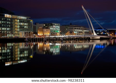 DUBLIN, IRELAND - AUG 23: Samuel Beckett Bridge, a cable-stayed bridge by architect Santiago Calatrava, open for maintenance at nighttime, on August 23, 2011 in Dublin, Ireland - stock photo