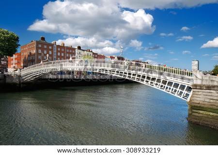 DUBLIN, IRELAND - AUGUST 3: Liffey Bridge known as Ha'penny Bridge is a pedestrian bridge over the river Liffey in Dublin City Centre on August 3, 2015 in Dublin, Ireland. Built in 1816 of cast iron - stock photo