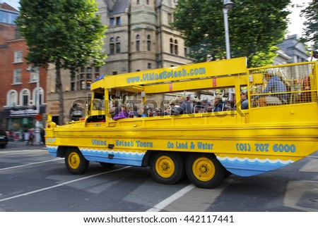DUBLIN, IRELAND - AUGUST 03, 2015: Tourists take a tour with a Viking amphibious vehicle in the streets of the center of Dublin in Ireland, on August 03, 2015