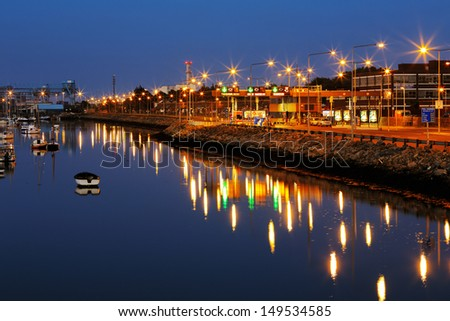 DUBLIN, IRELAND-JULY 22:Dublin Port at night as seen from the East-Link Toll Bridge on July 22, 2013 in Dublin, Ireland. It is Ireland's biggest sea port with a vast historical and economic importance - stock photo