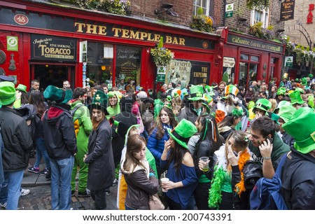 DUBLIN, IRELAND - MARCH 17: Saint Patrick's Day parade in Dublin Ireland on March 17, 2014: People dress up Saint Patrick's at The Temple Bar - stock photo