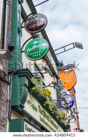 DUBLIN, IRELAND - 05 MAY, 2016: Beer signs in the Temple Bar area. The place is the cultural quarter in the center of the city and is full of restaurants, bars and nightclubs.