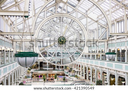 DUBLIN, IRELAND - 07 MAY, 2016: People walking in the Stephen's Green Shopping Centre. The complex is located in the Grafton Street, the most famous shopping area of the Irish capital. - stock photo