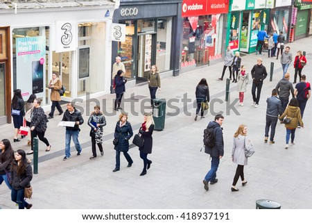 DUBLIN, IRELAND - 07 MAY, 2016: People walking on the Grafton Street. The main shopping street in the city is one of the most expensive in the world. - stock photo