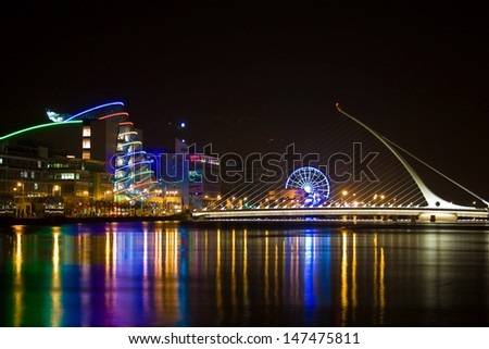 DUBLIN, IRELAND - October 04: Samuel Beckett Bridge, a cable-stayed bridge by architect Santiago Calatrava, open for maintenance at nighttime, on October 4, 2010  in Dublin, Ireland  - stock photo