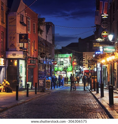 DUBLIN, IRELAND - SEPTEMBER 7, 2014: Nightlife at popular historical part of the city - Temple Bar quarter. The area is the location of many bars, pubs and restaurants - stock photo