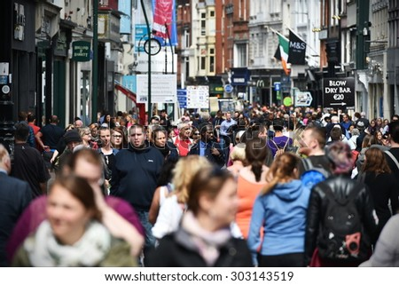 DUBLIN - JUL 22: Crowds of people walk on Grafton Street on Jul 22, 2015 in Dublin, Ireland. The street is a main tourist attraction in the Irish capital, renowned for its lively atmosphere and shops. - stock photo