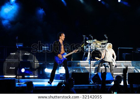 DUBLIN - JUNE 12 : Rick Savage (R) and Vivian Campbell (L) of Def Leppard rock group on stage during their 2009 tour at The O2 Dublin June 12, 2009 in Dublin.