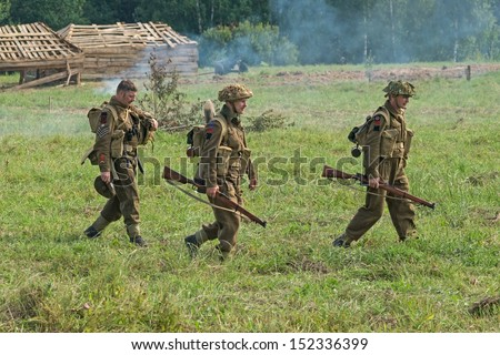 DUBOSEKOVO, RUSSIA - JULY 13:  military history club members in British 51st Highland Division uniform walk during Field of Battle military history festival on July 13, 2013 in Dubosekovo, Russia  - stock photo