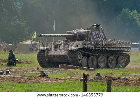 """DUBOSEKOVO, RUSSIA - JULY 13: PzKpfw.V """"Panther"""" tank advances during Field of Battle military history festival on July 13, 2013 in Dubosekovo, Russia  - stock photo"""