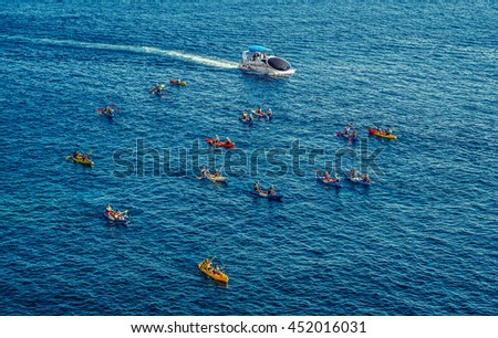 Dubrovnik, Croatia - August 26, 2015. Tourists paddles kayaks in Dubrovnik