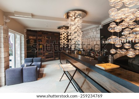 DUBROVNIK, CROATIA - MAY 28, 2014: Bar at the Restaurant 360 degrees on old wall. - stock photo