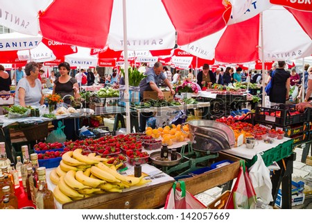 DUBROVNIK, CROATIA - MAY 12, 2013: Busy day at Dubrovnik's market. On 12 May 2013 in Dubrovnik, Croatia. - stock photo