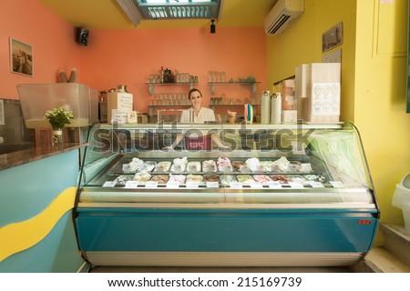 DUBROVNIK, CROATIA - MAY 26, 2014: Dolca vita ice cream parlour with friendly waitress - stock photo
