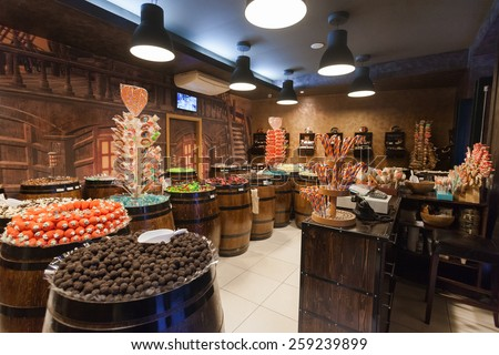 DUBROVNIK, CROATIA - MAY 28, 2014: Interior of the Candy shop Mateo with impressive range of treats, including chocolate, bonbons, and gummy bears all presented in pirate crates and barrels - stock photo