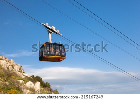 DUBROVNIK, CROATIA - MAY 26, 2014: Tourists in the Dubrovnik cable car. It connects Ploce and  mountain Srdj above town where you can enjoy a panoramic view of Old Town and the surrounding islands.