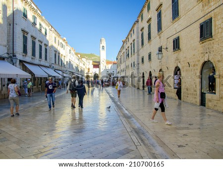 DUBROVNIK, CROATIA - MAY 15, 2013: Tourists walking on the main street Stradun in the old town of Dubrovnik, Croatia. On May 15, 2013 in Dubrovnik, Croatia