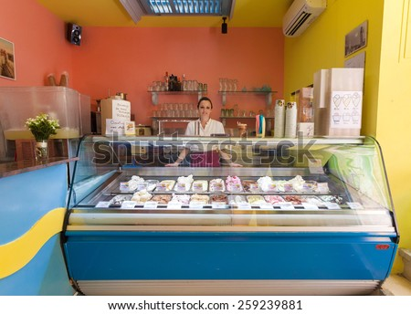 DUBROVNIK, CROATIA - MAY 26, 2014: Young waitress in Dolce vita, popular ice cream and cake shop. - stock photo