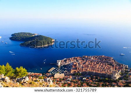 Dubrovnik Old Town and the Lokrum island on the Adriatic Sea in Croatia, aerial view - stock photo