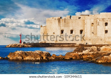 Dubrovnik old town pier at sunrise - stock photo
