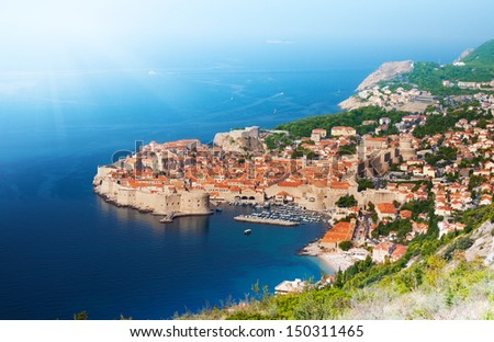 Dubrovnik old town, port and fortress walls from above - stock photo