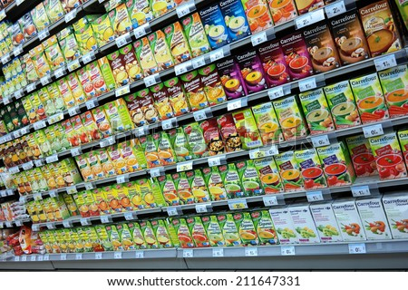 DUCEY, FRANCE - JULY 23:  Shelf filled with a huge variety cartons of prepared soup in a Carrefour supermarket, on July 23 2014 in Ducey, France  - stock photo