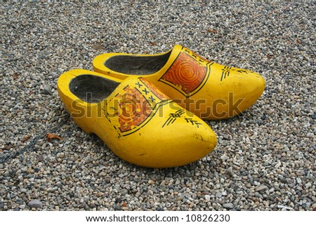 Duch wooden clogs on the peeble, with clipping path - stock photo