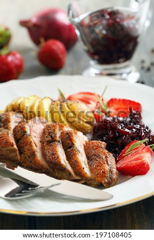 Duck breast with a sauce of red onion and strawberry.