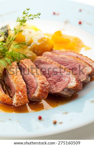 Duck Breast with Orange and Potato - stock photo