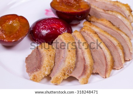 Duck Breasts with Roasted Plums - stock photo