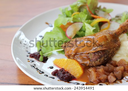 Duck confit , Roasted duck with blueberry sauce - stock photo