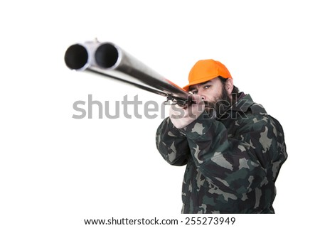 Duck hunter with orange safety hat aiming a double barreled shotgun on a white background - stock photo