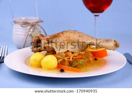 Duck leg with braised cabbage, potato and gravy, close up - stock photo