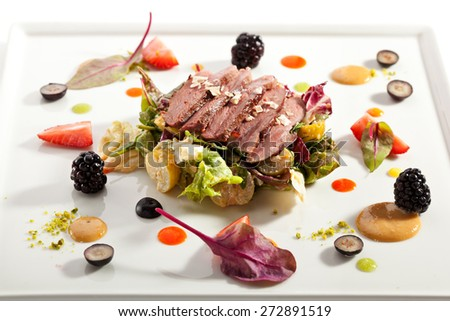 Duck Magret with Vegetables, Fruits and Berries - stock photo