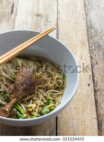 Duck noodle on wooden background. thai food