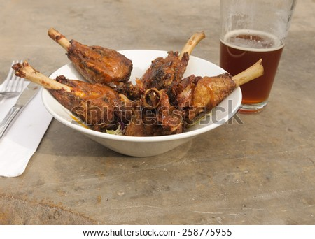 Duck wings and beer appetizer - stock photo