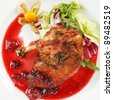 duck wings with cranberry sauce - stock photo