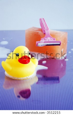 ducky w/ soap and razor - focus on ducky - stock photo