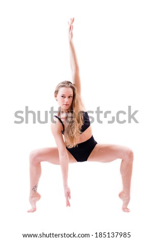 ductile flexible beautiful blond young woman performer dancer standing on tiptoe bent knees isolated on white background portrait - stock photo