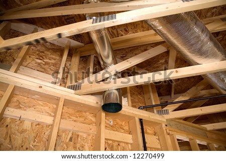 Ductwork in new adobe home under construction. - stock photo