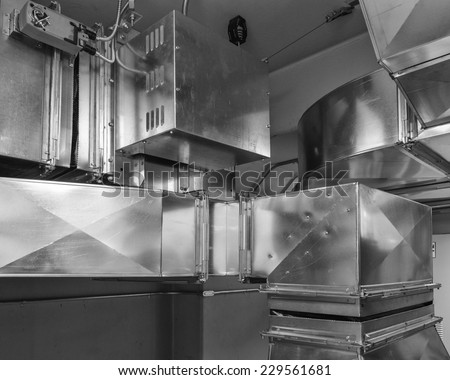 Ductwork with damper actuatorcontrols air flow into an air conditioned space. - stock photo