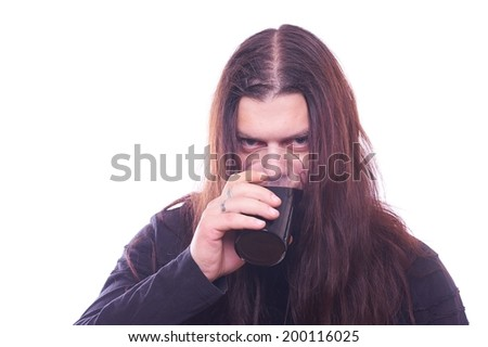 Dude with flowing hair drink beer, studio shot - stock photo